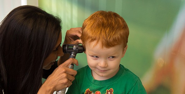 Child Being Examined By Doctor